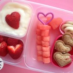 Watermelon heart skewers, mini heart almond butter sandwiches, vanilla yogurt, strawberries, yogurt covered pretzels