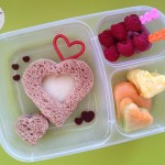 Cheese sandwich hearts, raspberries, melon and pineapple hearts