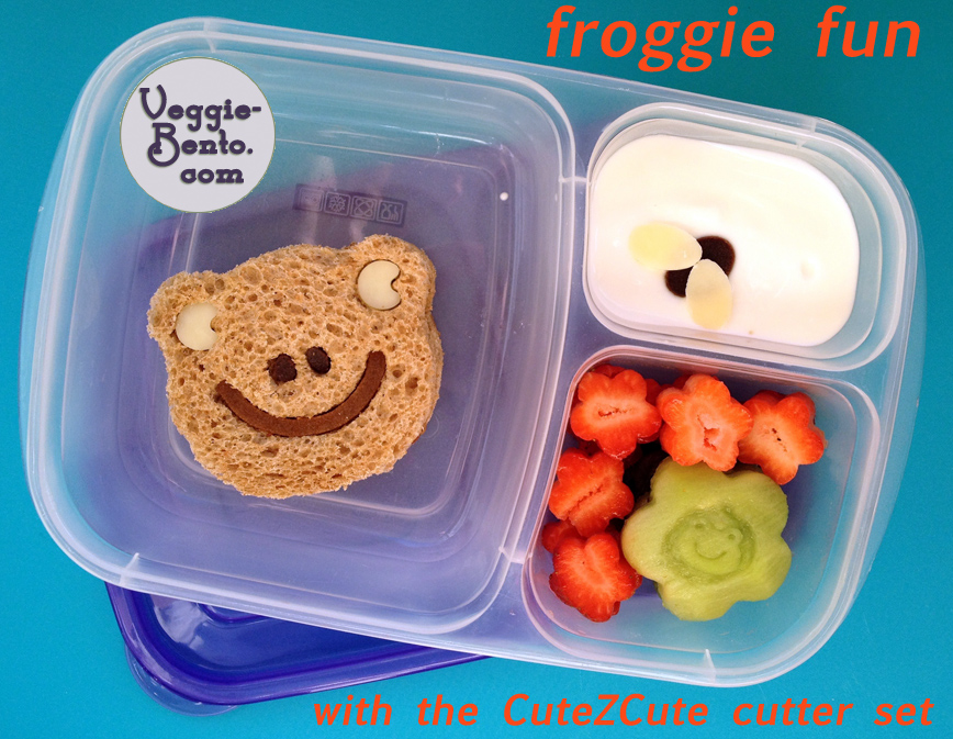 Froggie fun lunch - a cute frog eyes a fly in the yogurt