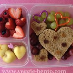 Cheesey bean bite hearts, almond butter sandwiches, berries