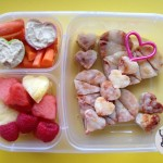 Pizza cut up with a Funbites LuvIt cutter, fruit, carrots and hummus