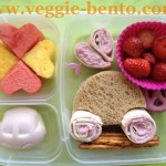Tortilla and strawberry cream cheese roll ups, car shaped egg dyed with natural colors, fruit