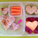 Leftover pizza, carrots and hummus frozen into heart shapes, melon and berries